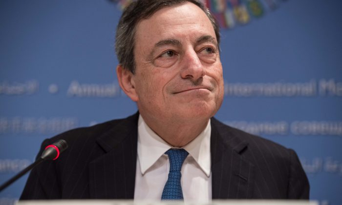 European Central Bank (ECB) President Mario Draghi at the annual IMF/World Bank meetings in Washington on Oct. 11. During the summer, the ECB announced that it would impose an interest rate charge on euro deposits. (Nicholas Kamma/AFP/Getty Images)