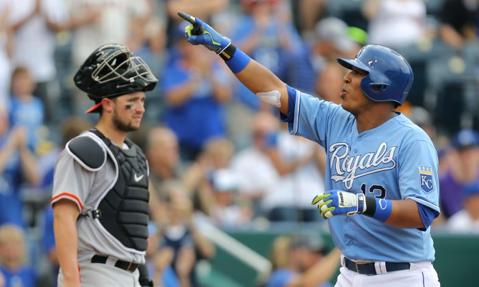 Salvador Perez (R) of the Kansas City Royals celebrates his two-run home run as Andrew Susac of the San Francisco Giants looks on. Kansas City will need more from Perez, who has just four hits this postseason, to beat San Francisco. (Ed Zurga/Getty Images)