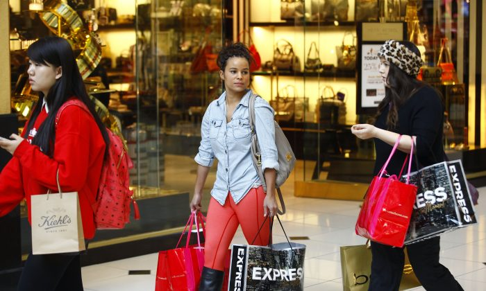 Shoppers walk with bags as they take advantage of Black Friday deals at Somerset Collection shopping mall on November 29, 2013 in Troy, Michigan. Black Friday is one of the busiest shopping days of the year, where retailers offer discounted merchandise. (Joshua Lott/Getty Images)