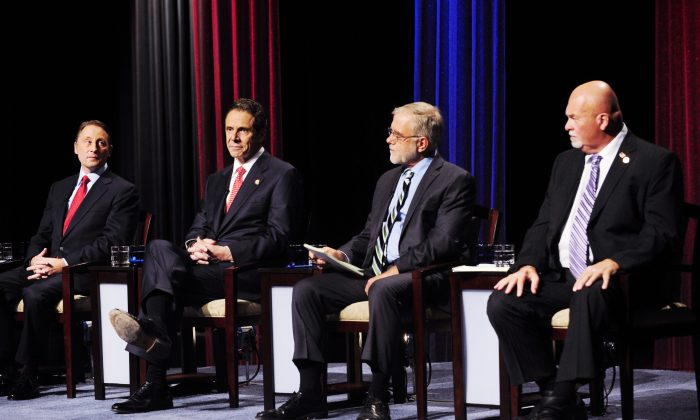 New York State gubernatorial candidates (L-R) Republican candidate Rob Astorino, Democratic incumbent Andrew Cuomo, Green Party candidate Howie Hawkins, and Libertarian Party candidate Michael McDermott take the stage for a debate in Buffalo, N.Y, Oct. 22. (AP Photo/Gary Wiepert)
