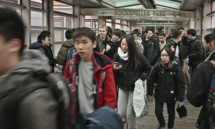 Students leave Stuyvesant High School, one of the nine specialized public high schools in New York City, March 25, 2014. Council members introduced three bills Wednesday aimed at ending school segregation, including one to reform the specialized admissions process to let in more blacks and Latinos. (AP Photo/Bebeto Matthews)