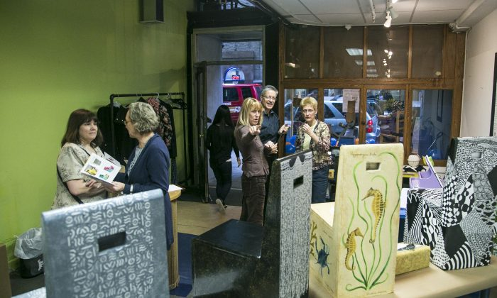 Decorated chairs made out of cardboard are on display at the Adaptive Design Association's Manhattan office in New York, Thursday, October 23, 2014. The artwork was part of a charity auction to benefit the nonprofit organization, which builds customized furniture made out of cardboard for disabled children. (Samira Bouaou/Epoch Times)