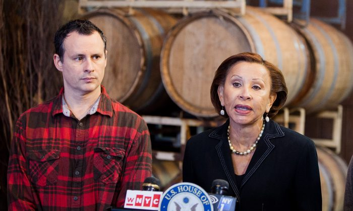 Mark Snyder, owner of the Red Hook Winery, and New York Congresswoman Nydia Velázquez criticize the Small Business Administration's response after Superstorm Sandy at Red Hook Winery in Brooklyn, N.Y., on Oct. 23, 2014. (Petr Svab/Epoch Times)