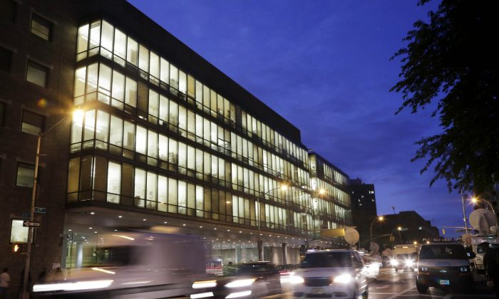Traffic passes Bellevue Hospital, Friday, Oct. 24, 2014, in New York. A new patient has developed a fever in the hospital after visiting one of the three West African countries afflicted with Ebola. (AP Photo/Mark Lennihan)