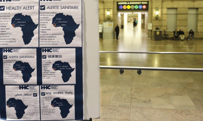 Health alerts regarding people who may have traveled to particular West African countries are posted in the lobby of Bellevue Hospital, Friday, Oct. 24, 2014, in New York. Dr. Craig Spencer, a resident of New York City and a member of Doctors Without Borders, was admitted to Bellevue Thursday and has been diagnosed with Ebola. (AP Photo/Mark Lennihan)