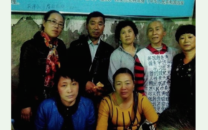 The picture of petitioners from Shandong, Heilongjiang, Liaoning and Jilin is taken at Number 37 Police Station in Beijing. (Picture from Human Rights Campaign in China website)