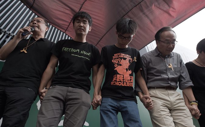 (L-R) Benny Tai of prominent pro-democracy group Occupy Central and Hong Kong student leaders Alex Chow, Joshua Wong and Alan Leong, of the Civic Party attend a press conference at the pro-democracy protesters camp site in the Admiralty district of Hong Kong on October 26, 2014. Hong Kong's pro-democracy protesters were on October 26 forced to suspend a planned vote on their next steps -- hours before it was due to begin -- due to differing opinions about how to move their month-long campaign forward. (Nicolas Asfouri/AFP/Getty Images)