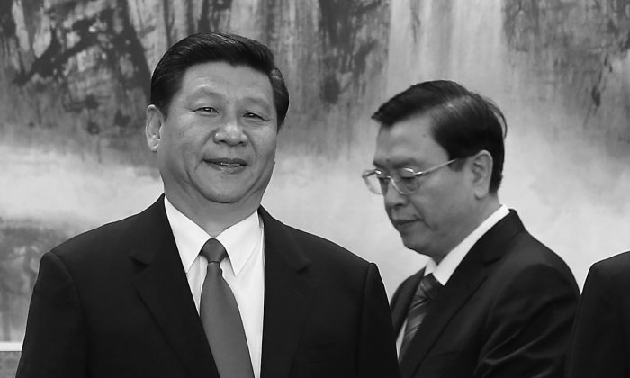 Politburo Standing Committee member Zhang Dejiang stands behind Xi Jinping, just after he was formally appointed to head the Chinese Communist Party, in the Great Hall of the People on Nov. 15, 2012 in Beijing. Hong Kong magazines have reported that Zhang was part of a plot to create chaos in Hong Kong in order to bring trouble to Xi. (Lintao Zhang/Getty Images)