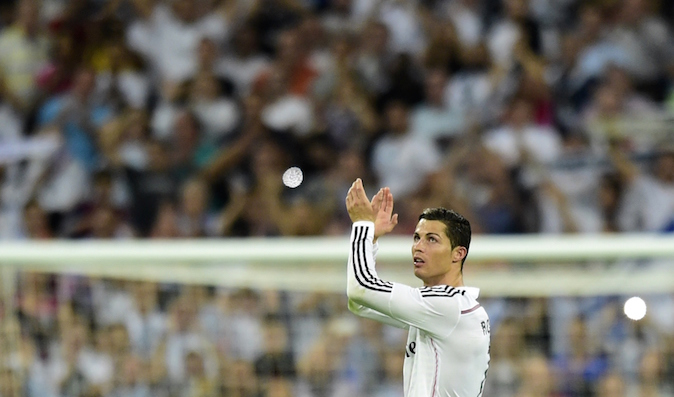 Real Madrid's Portuguese forward Cristiano Ronaldo applauds supporters after beating Barcelona during the Spanish league football match Real Madrid CF vs FC Barcelona at the Santiago Bernabeu stadium in Madrid on October 25, 2014. (Javier Soriano /AFP/Getty Images)
