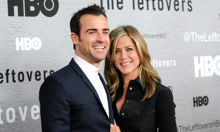 "Actors Justin Theroux and Jennifer Aniston attend HBO's ""The Leftovers"" season premiere at the NYU Skirball Center on Monday, June 23, 2014 in New York. (Photo by Evan Agostini/Invision/AP)"