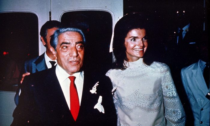 """Aristotle Onassis stands with his new wife Jacqueline Kennedy after their marriage in the tiny chapel on the Island of Scorpios in Greece on Oct. 20, 1968.  Jackie and Aristotle are seen aboard the yacht  """"Christina.""""  (AP Photo)"""