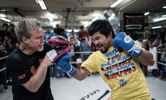 Philippine boxing icon Manny Pacquiao (R) takes part in a sparring session during a media call in Hong Kong on October 27, 2014. (AFP/Getty Images)