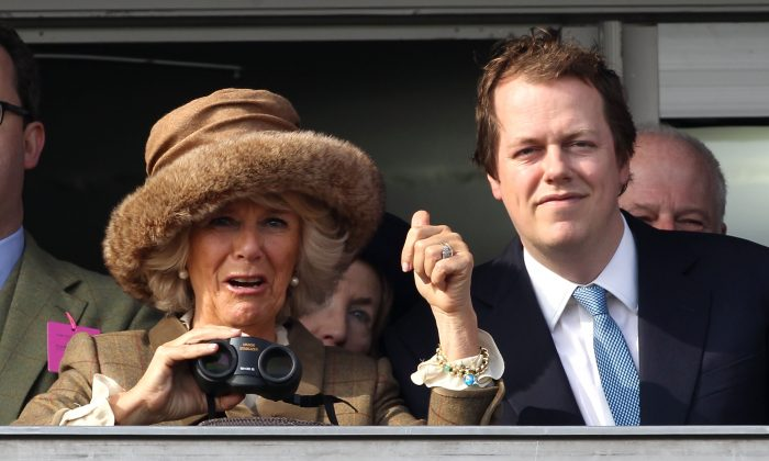 Camilla, Duchess of Cornwall and Tom Parker Bowles watch the first race, Camilla, Duchess of Cornwall celebrates winning the race on Ladies Day, day 2 of The Cheltenham Festival at Cheltenham Racecourse on March 12, 2014 in Cheltenham, England. (Photo by Danny E. Martindale/Getty Images)