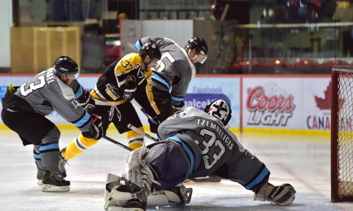 Leading goal scorer, Kory Falite of Hong Kong Tycoons torments the Shark's defence during their HK CIHL match at Mega Ice on Saturday Oct 25, 2014. Tycoons came out on top 8-6 in this high scoring game. (Bill Cox/Epoch Times)