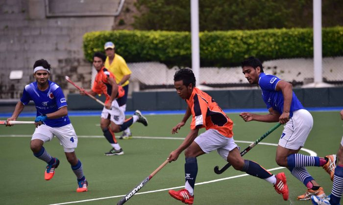 Fast action and an electric atmosphere throughout the game added to the pleasure for spectators at the HKHA Premier Division match between Punjab-A and SSSC-A at King's Park on Saturday Oct 26, 2014. (Bill Cox/Epoch Times)