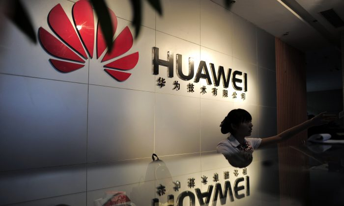 A receptionist at the office of Chinese telecommunications firm Huawei in Wuhan City, China on Oct. 8, 2012. (STR/AFP/Getty Images)