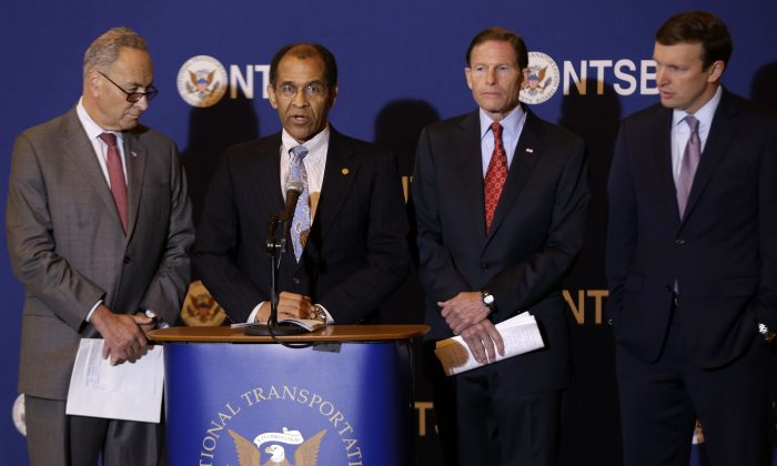Officials announce causes of five Metro-North accidents in the past year, in Manhattan, New York, Tuesday, Oct. 28, 2014. (L–R) Senator Chuck Schumer (D-NY); Christopher Hart, acting chairman of the National Transportation Safety Board; Senator Richard Blumenthal (D-CT); and Senator Chris Murphy (D-CT). (AP Photo/Seth Wenig)