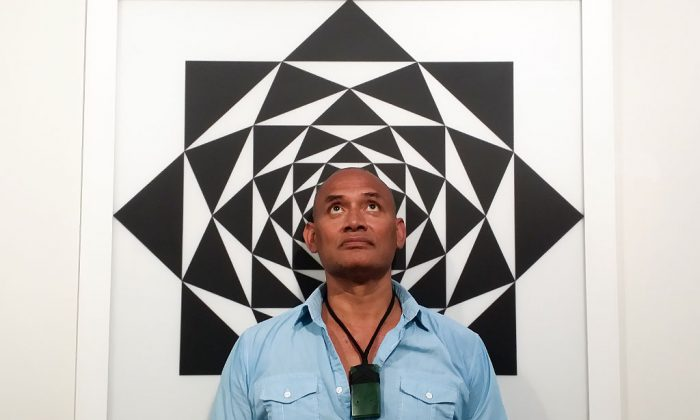 "Artist Uili Lousi with his piece, ""The Secret of the Golden Flower,"" 2010. Acrylic on perspex. (Courtesy of Uili Lousi)"
