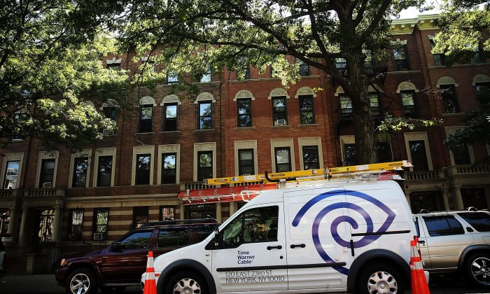 A Time Warner Cable truck in Brooklyn doing repairs on August 27, 2014 in New York City. Comcast is in the process of buying TWC is a $45 billion merger, which is undergoing review by state and federal agencies. (Spencer Platt/Getty Image)