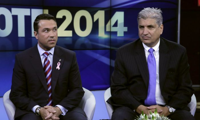 Republican Congressman Michael Grimm (L) and Democratic opponent Domenic M. Recchia Jr. during the run-up to their previous, more acrimonious debate on WABC-TV in New York City, October 17, 2014. (Richard Drew-Pool/Getty Images)