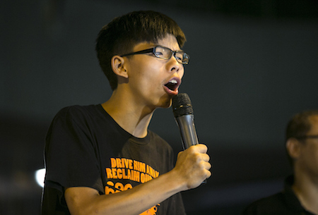 Student leader Joshua Wong speaks at a pro-democracy protest site outside the central government offices on October 19, 2014 in Hong Kong. (Paula Bronstein/Getty Images)