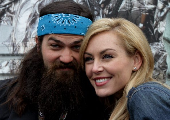 Jep Robertson and Jessica Robertson greet fans in the Duck Commander Compound at Texas Motor Speedway on April 5, 2014 in Fort Worth, Texas. (Photo by Jerry Markland/Getty Images for Texas Motor Speedway)