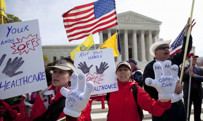 FILE - In this March 28, 2012 file photo, protesters chant in front of the Supreme Court in Washington as the court concludes three days of hearing arguments on the constitutionality of President Barack Obama's health care overhaul, the Patient Protection and Affordable Care Act. Supreme Court justices have their first chance this week to decide whether they have the appetite for another major fight over President Barack Obama's health care law. Some of the same players who mounted the first failed effort to kill the law altogether now want the justices to rule that subsidies that help millions of low- and middle-income people afford their premiums under the law are illegal. (AP Photo/Carolyn Kaster, File)