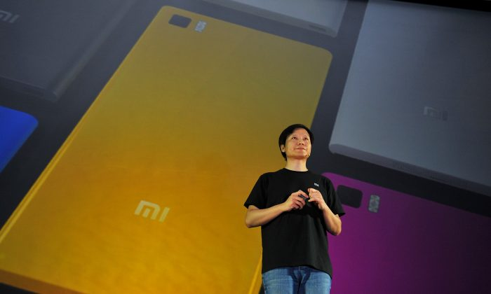 Xiaomi CEO Leijun attends the launch of the new Xiaomi smartphone and Xiaomi Tv in Beijing on September 5, 2013.  Apple is highly unlikely to sue Xiaomi due to its reluctance to stand up to the Chinese government. (Wang Zhao/AFP)