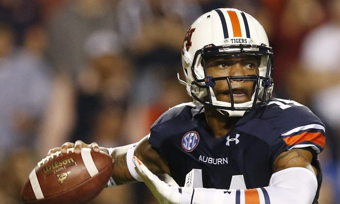 Auburn quarterback Nick Marshall (14) sets back to throw the ball against South Carolina during the second half of an NCAA college football game Saturday, Oct. 25, 2014, in Auburn, Ala. Auburn won 42-35. (AP Photo/Brynn Anderson)