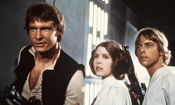 """Harrison Ford (Han Solo), Carrie Fisher (Princess Leia), and Mark Hamill (Luke Skywalker) in a scene from the 1977 """"Star Wars"""" movie released by 20th Century-Fox. (AP Photo/20th Century-Fox Film Corporation, File)"""