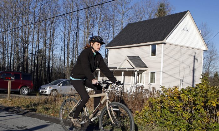 Nurse Kaci Hickox leaves her home on a rural road in Fort Kent, Maine, to take a bike ride with her boyfriend Ted Wilbur, on Oct. 30. State officials are going to court to keep Hickox in quarantine for the remainder of the 21-day incubation period for Ebola that ends on Nov. 10. (AP Photo/Robert F. Bukaty)