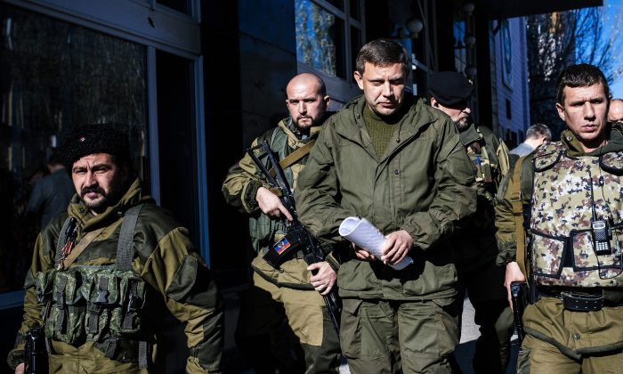 Pro-Russian gunmen guard Alexander Zakharchenko (C), Prime Minister of the self-proclaimed Donetsk Peoples Republic and presidential candidate on October 31, 2014 in Donetsk. (AFP/Getty Images)