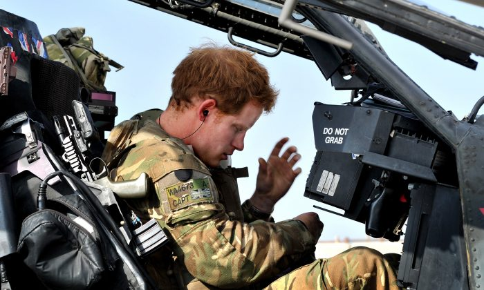 In this image released on January 21, 2013, Prince Harry sits in the front seat of his cockpit in Camp Bastion on October 31, 2012 in Afghanistan. (John Stillwell/PA Wire)
