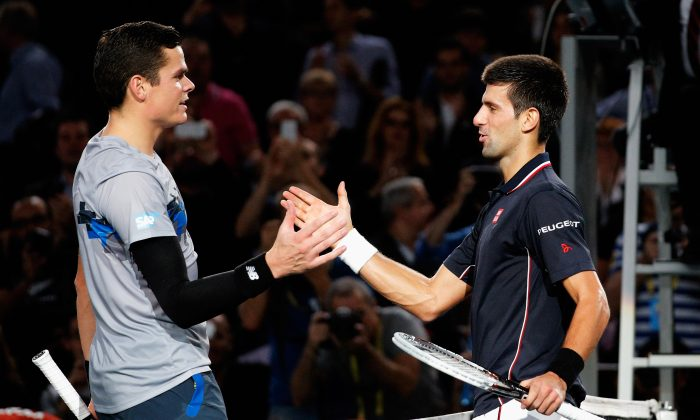 Milos Raonic (L) shakes hands with BNP Paribas Masters champion Novak Djokovic at the Palais Omnisports de Bercy on Nov. 2, 2014 in Paris, France. (Dean Mouhtaropoulos/Getty Images)