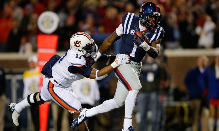 Wide receiver Laquon Treadwell (R) of the Mississippi Rebels made it all the way to the goal line before fumbling the ball away while suffering a broken leg on the play that changed the game against the Auburn Tigers, who won 35–31. (Doug Pensinger/Getty Images)