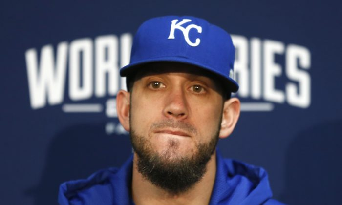 FILE - In this Oct. 20, 2014, file photo, Kansas City Royals starting pitcher James Shields listens to a question during a news conference at Kauffman Stadium in Kansas City, Mo. The Royals extended a $15.3 million qualifying offer Monday, Nov. 3, 2014,  to Shields, which assures Kansas City of draft pick compensation if its staff ace signs a major league contract with another team before June 8. (AP Photo/Orlin Wagner, File)