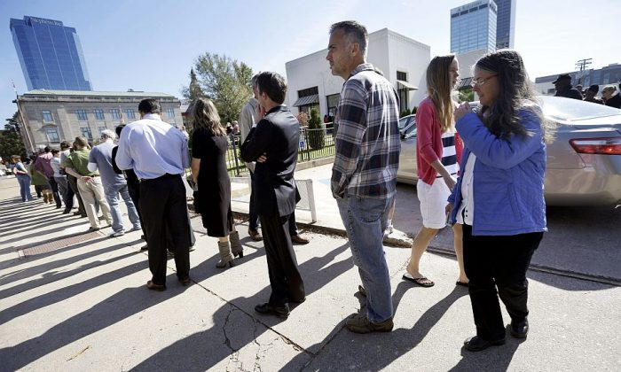 Voters wait in line to vote early in Little Rock, Ark., on Nov. 3, 2014. (AP Photo/Danny Johnston)