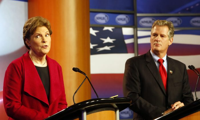 U.S. Sen. Jeanne Shaheen, D-Maine, left, answers a question during a live televised debate with her Republican opponent, former Massachusetts U.S. Sen. Scott Brown, at Saint Anselm College in Manchester, N.H. on Thursday, Oct. 30, 2014. (AP Photo/Jim Cole)