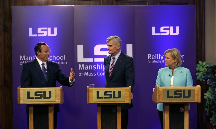 Sen. Mary Landrieu, D-La., Rep. Bill Cassidy, R-La., and Republican candidate and Tea Party favorite Rob Maness participate in a Senate race debate on the LSU campus in Baton Rouge, La., Wednesday, Oct. 29, 2014. (AP Photo/Gerald Herbert)