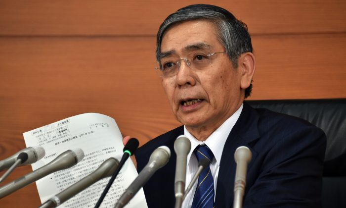 Bank of Japan governor Haruhiko Kuroda speaks to the press in Tokyo on Oct. 31, 2014. The Bank of Japan ramped up its vast monetary easing programme following a string of poor data that has fanned fears the economy may contract again in the third quarter. (Yoshikazu Tsuno/AFP/Getty Images)