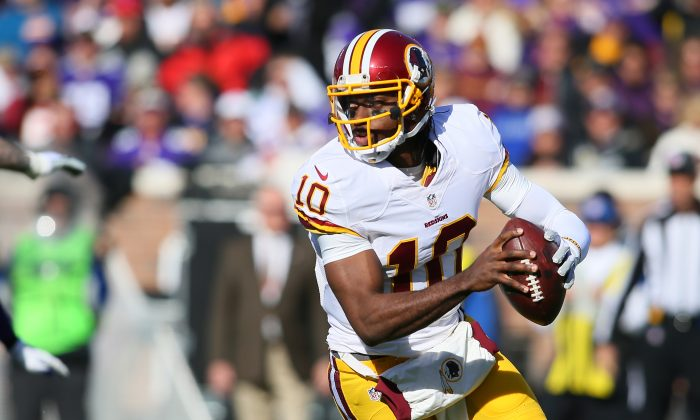 Robert Griffin III #10 of the Washington Redskins looks to pass the ball against the Minnesota Vikings during the first quarter on November 2, 2014 at TCF Bank Stadium in Minneapolis, Minnesota. (Photo by Adam Bettcher/Getty Images)