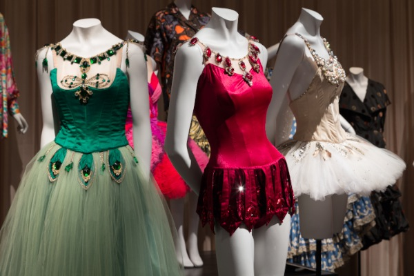 """Installation view of Dance & Fashion, featuring costumes by Barbara Karinska for New York City Ballet's """"Jewels."""" (Photograph © The Museum at FIT, New York)."""