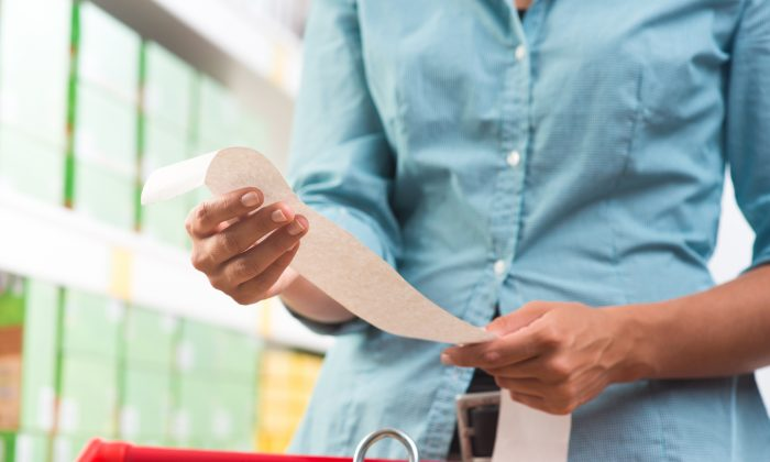 Don't touch receipts for too long, especially with wet hands. Shutterstock