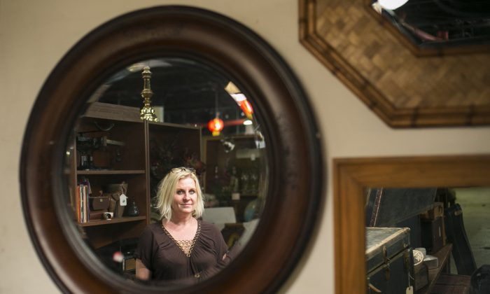 Eva Radke, founder of Film Biz Recycling, in her prop shop and drop-off center in Gowanus, Brooklyn, New York, on Oct. 30, 2014. The non-profit has reduced hundreds of tons of waste in New York City since 2008. Props, furniture, and wardrobe items donated from local film, television, and theater sets are given to charities, recycled, and sold for discount at Film Biz Recycling in Gowanus. (Samira Bouaou/Epoch Times)