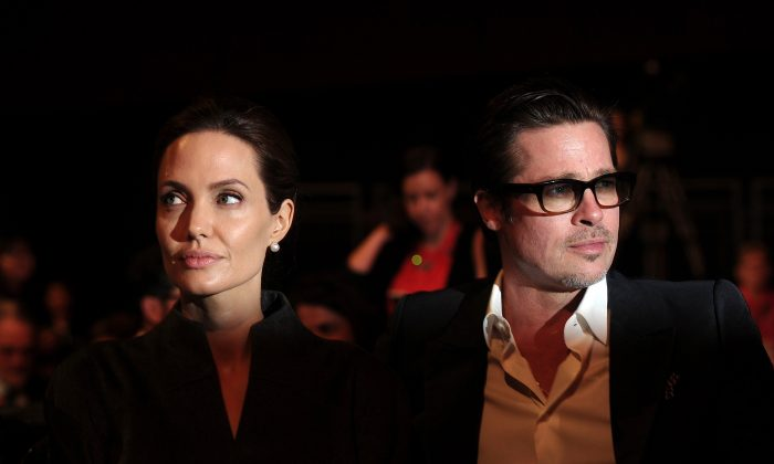 US actress and special UN envoy Angelina Jolie (L) and her husband US actor Brad Pitt attend the fourth day of the Global Summit to End Sexual Violence in Conflict in London on June 13, 2014. (Carl Court/AFP/Getty Images)