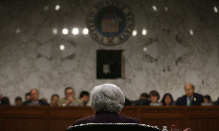 Federal Reserve Chair Janet Yellen testifies about the economy before the Joint Economic Committee of Congress on Capitol Hill in Washington, Wednesday, May 7, 2014. (AP Photo/Charles Dharapak)