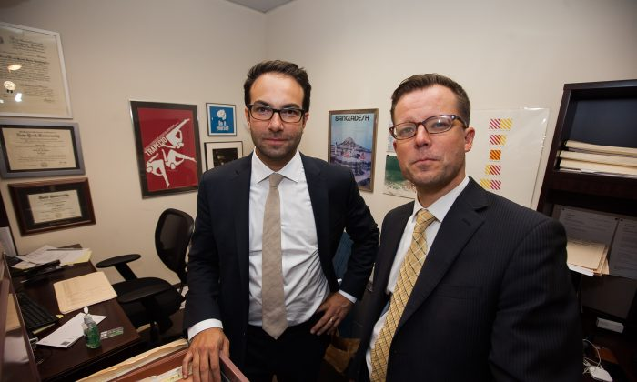 Josh Saunders (R) and Scott Hechinger (L), public defenders and co-founders of the Brooklyn Community Bail Fund, in Hechinger's office at the Brooklyn Defender Services, Downtown Brooklyn, New York, on Nov. 5, 2014. Brooklyn Defender Services is a public defender office that offers legal and social services to the indigent. (Petr Svab/Epoch Times)