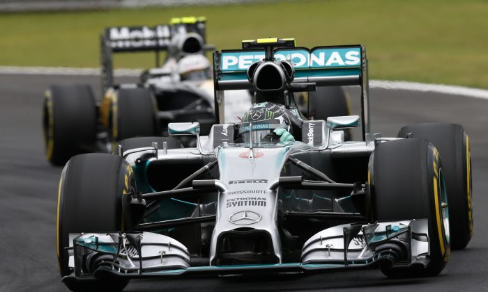 Mercedes driver Nico Rosberg, of Germany, steers his car in the qualifying session for the Formula One Brazilian Grand Prix at the Interlagos race track in Sao Paulo, Brazil, Saturday, Nov. 8, 2014. Rosberg clocked the fastest time (AP Photo/Andre Penner)
