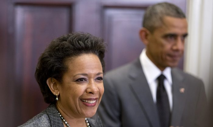 President Barack Obama listens at right as US Attorney Loretta Lynch speaks in the Roosevelt Room of the White House in Washington, Saturday, Nov. 8, 2014, where the president announced he would nominate Lynch to replace Attorney General Eric Holder. (AP Photo/Carolyn Kaster)