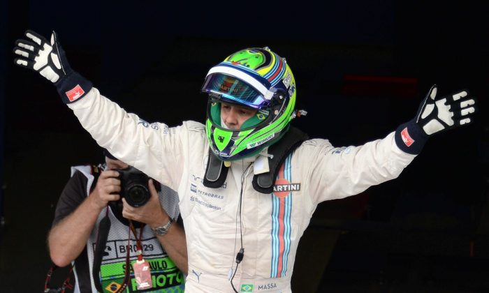 Nico Rosberg celebrates after winning the Formula One Brazilian Grand Prix at the Interlagos racetrack in Sao Paulo, Brazil on November 9, 2014. (Nelson Almeida/AFP/Getty Images)
